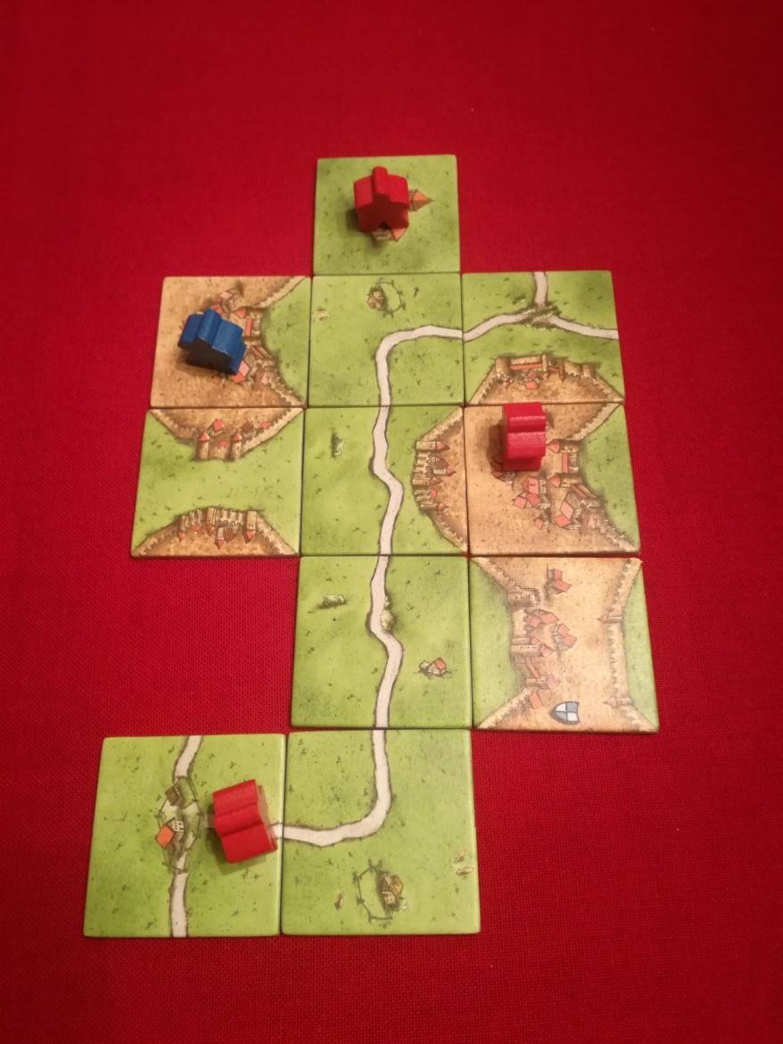 Red starting with a heavy road Carcassonne strategy.