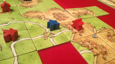 Two player game of Carcassonne with a farm strategy.