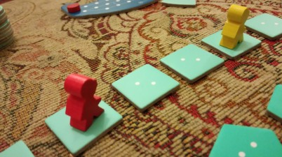 Diver meeples up close.