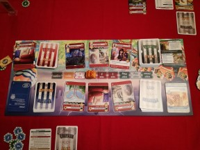 The game board is two sided for both across-the-table and side-by-side play.