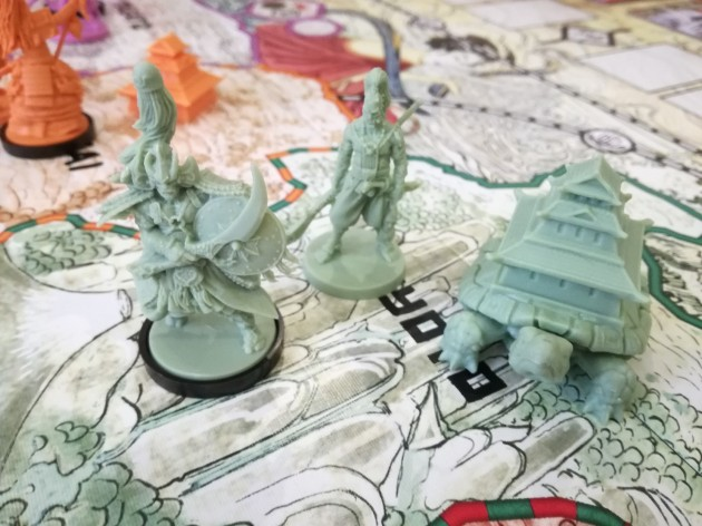 Turtle Clan Rising Sun Strategy: The Turtle Clan minis from the Kickstarter edition. I believe the fortress is different in the base game.