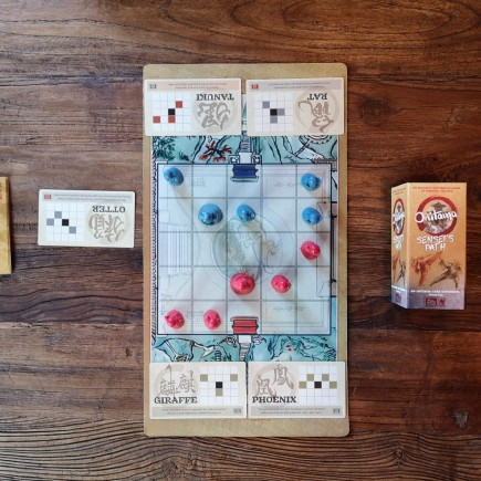 Onitama and game set up for the Sensai's Path.