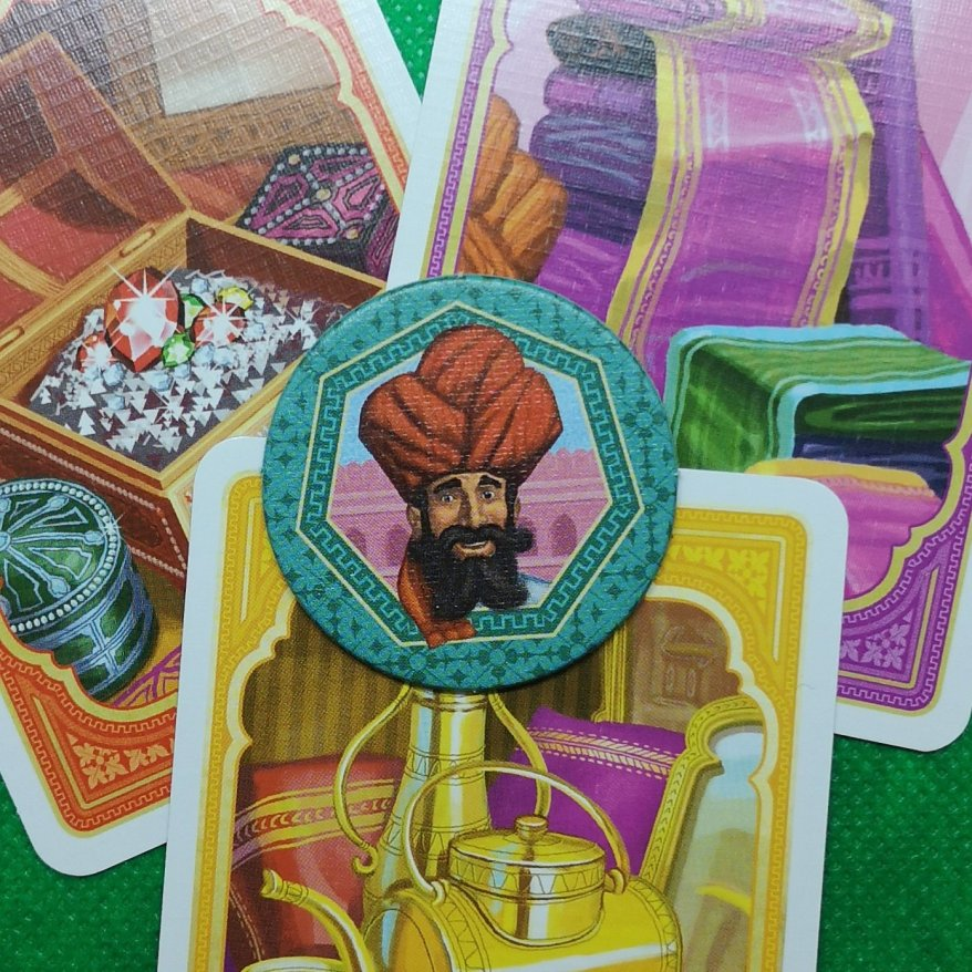 Jaipur: The winner token (best two of three) and card art.